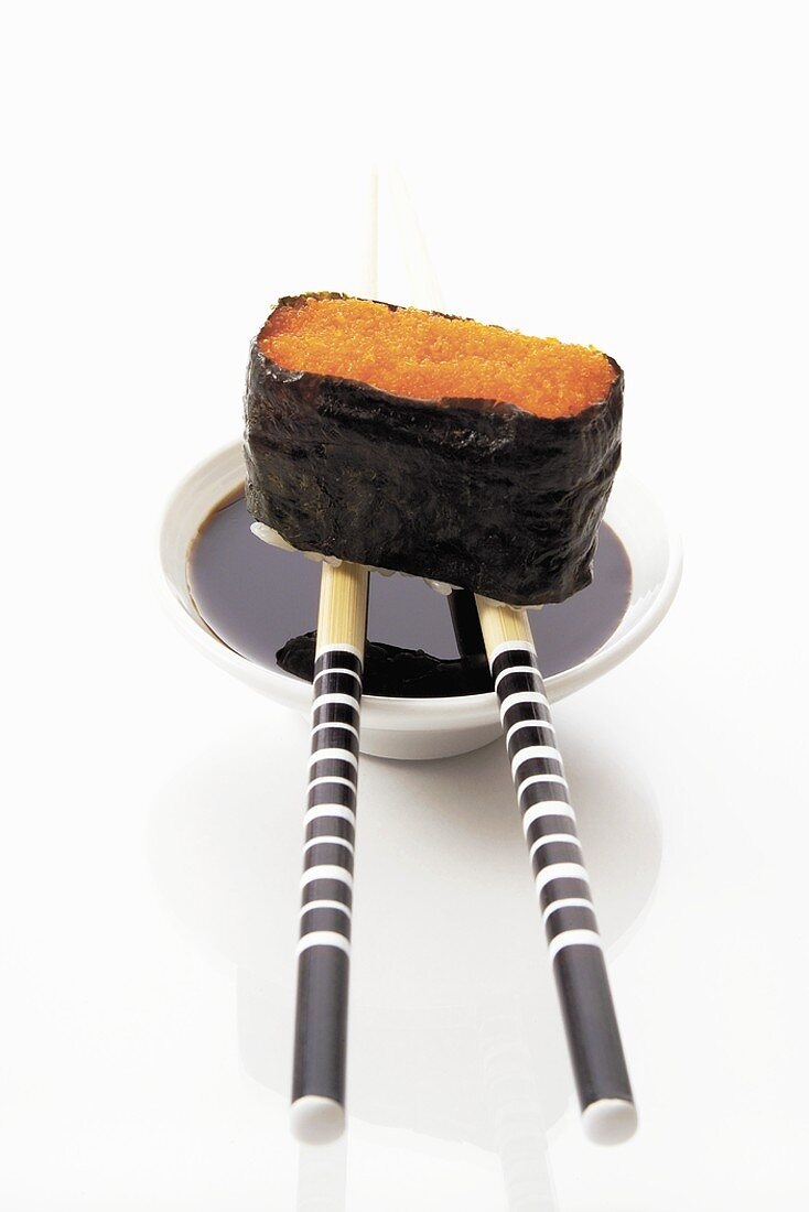 Gunkan maki with soy sauce and chopsticks