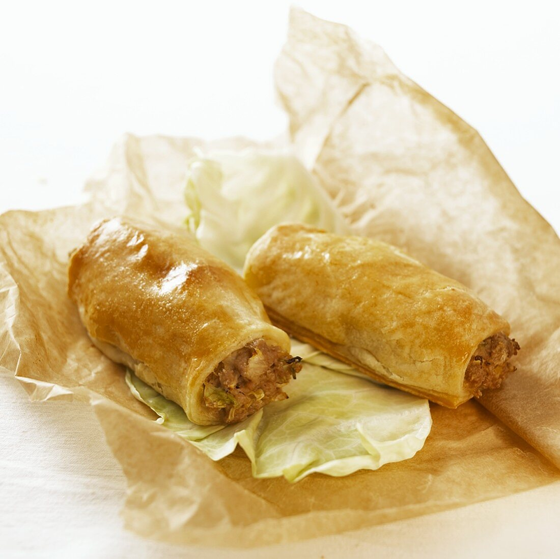 Puff pastry rolls with mince and cabbage filling