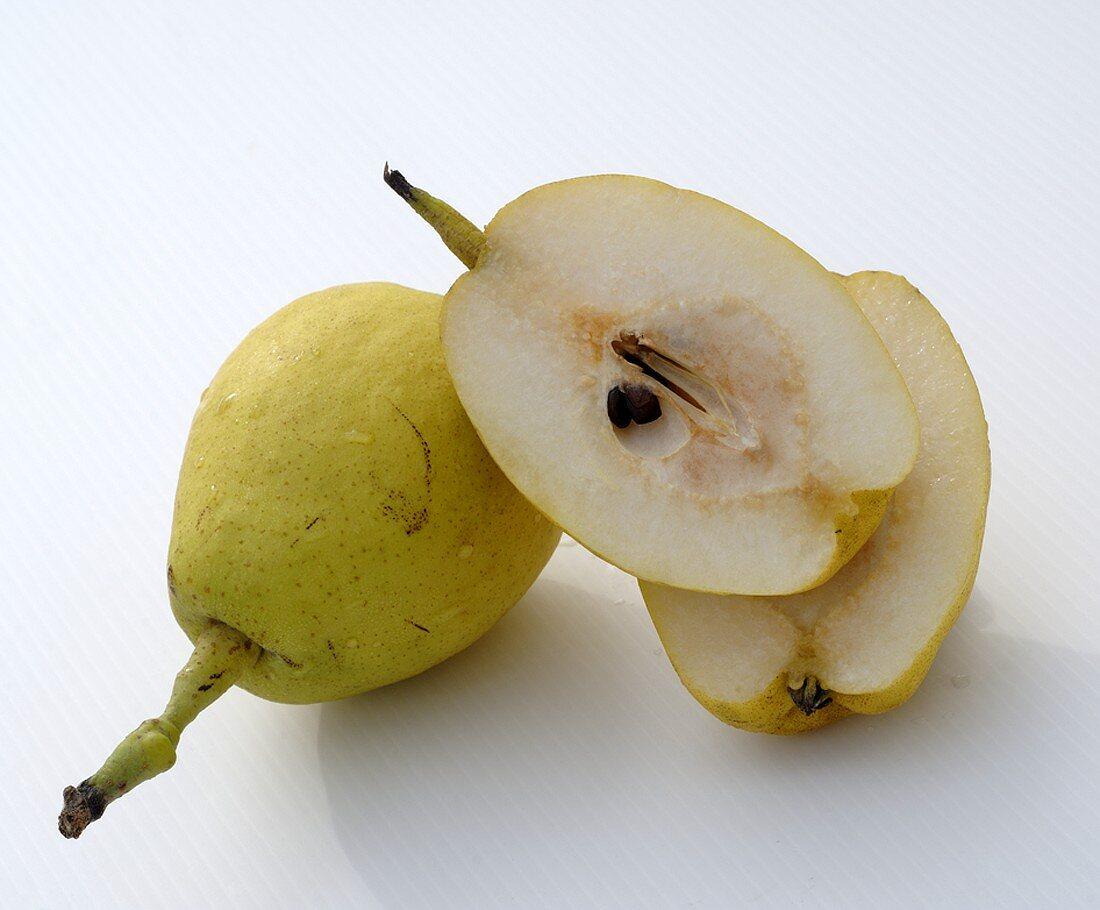 Whole and halved Nashi pears