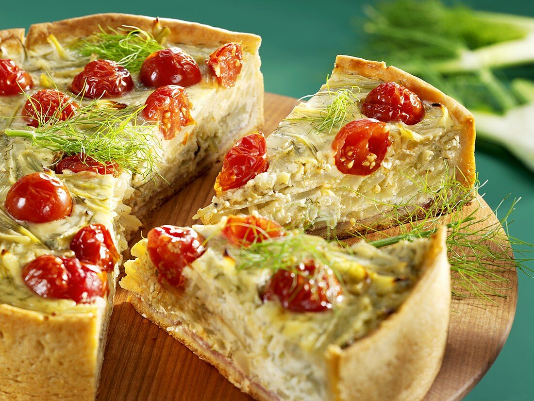 A fennel and tomato tart, partly sliced