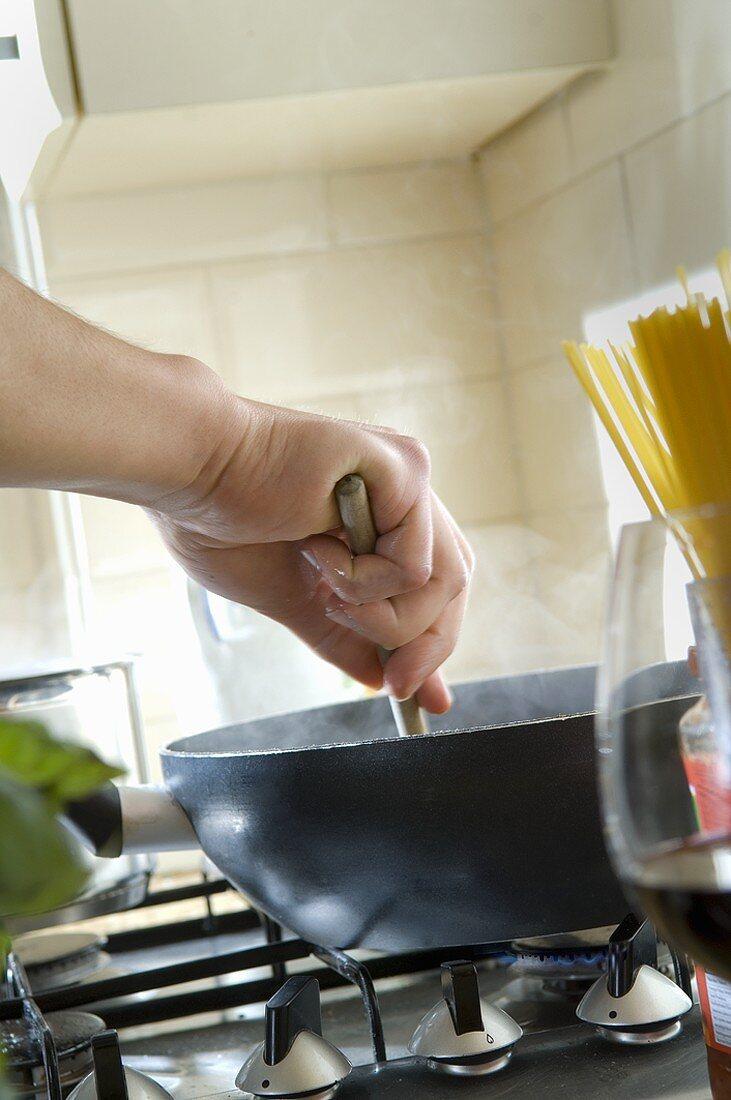 Turning ingredients in a frying pan