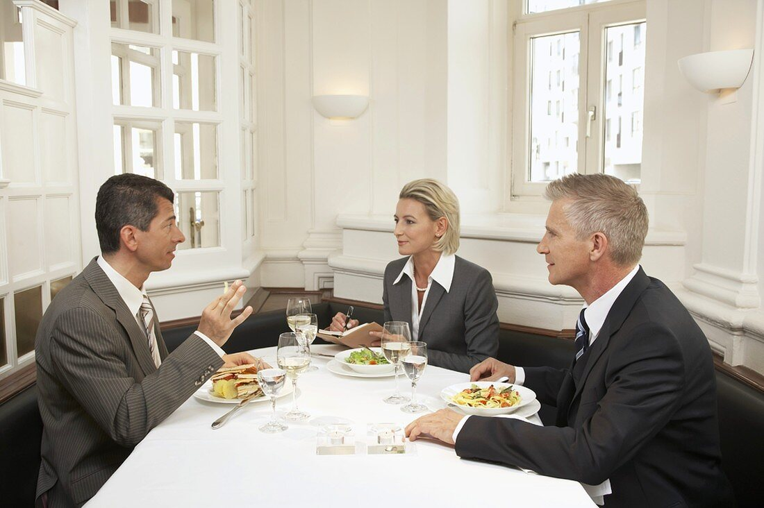 Three business people having a meal together
