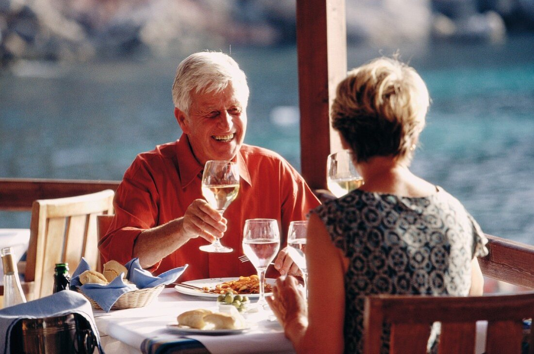 Married couple in restaurant by the sea (Greece)