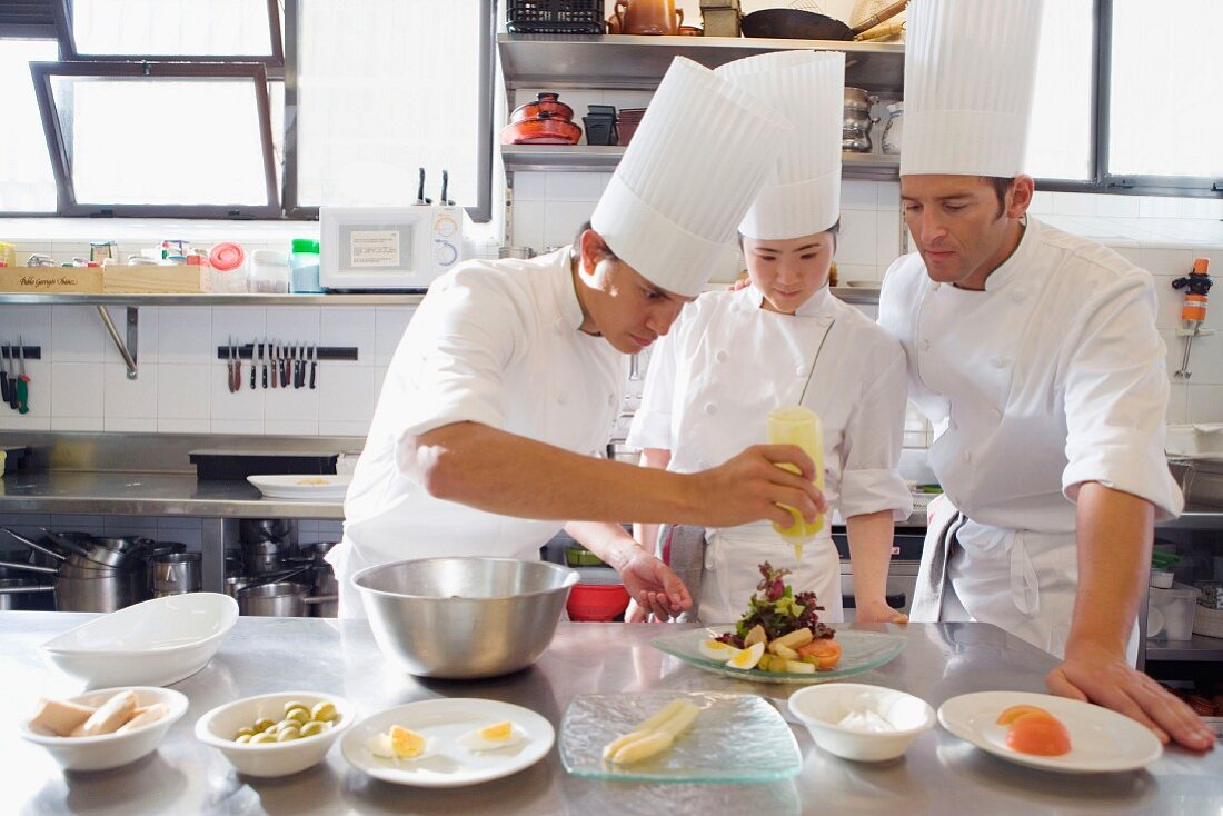 Three Chefs In A Commercial Kitchen License Images 947050 Stockfood