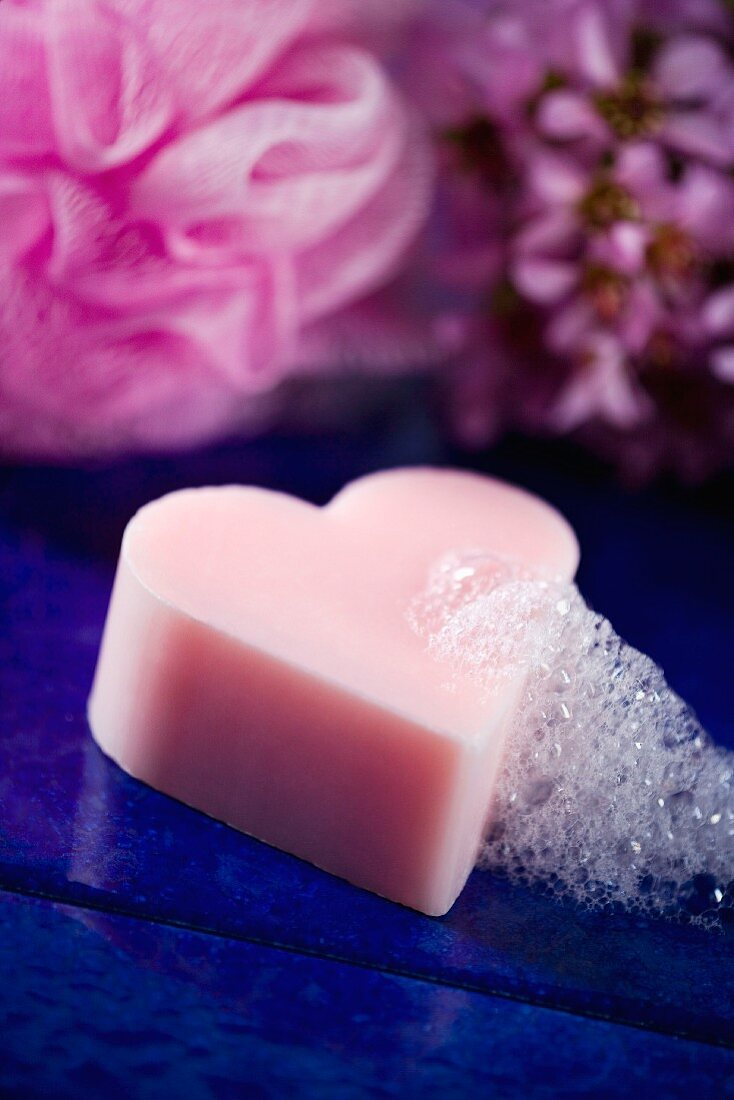 Heart-shaped bar of soap with lather