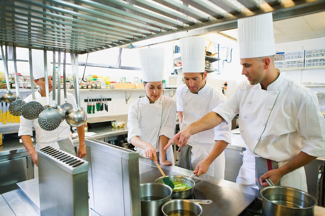 Chefs cooking asparagus in a commercial kitchen