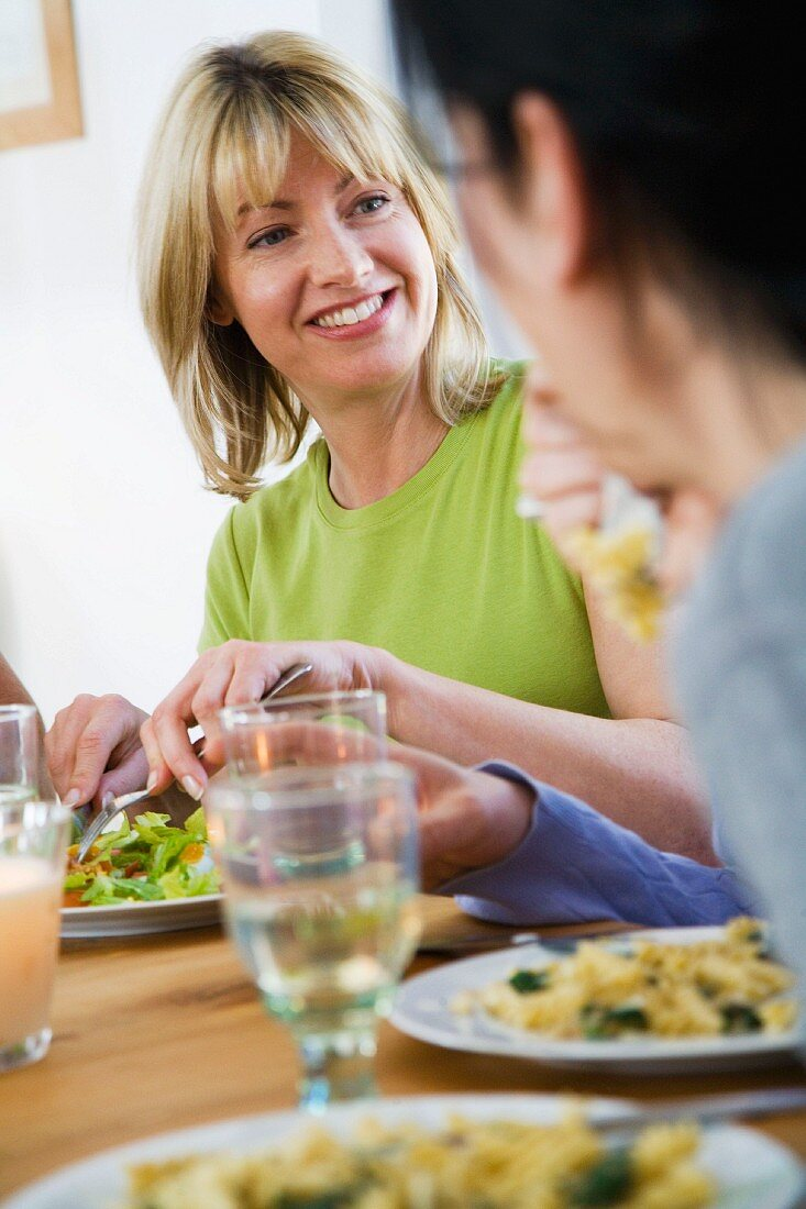 Friends eating dinner in dining room