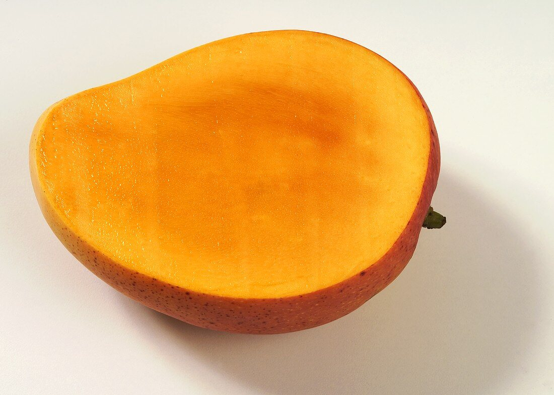 A mango with a slice removed