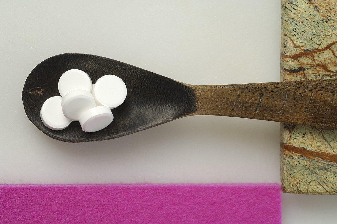 Schüssler Salts on wooden spoon