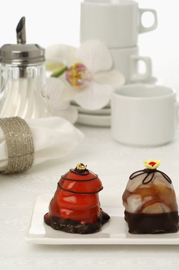 Coffee things with sugar dispenser and petit fours