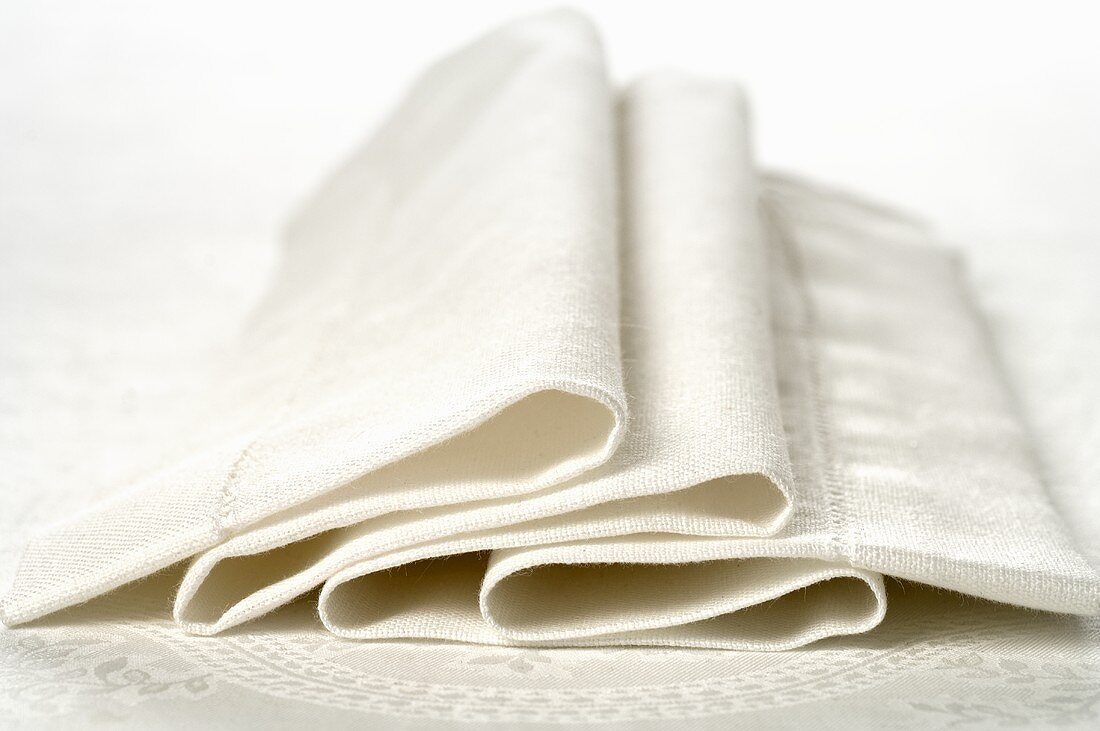 Folded white fabric napkin