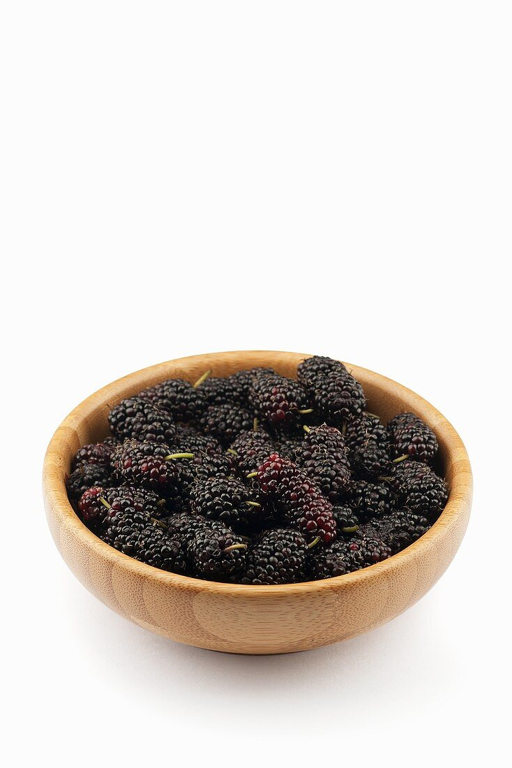 Mulberries in a wooden bowl