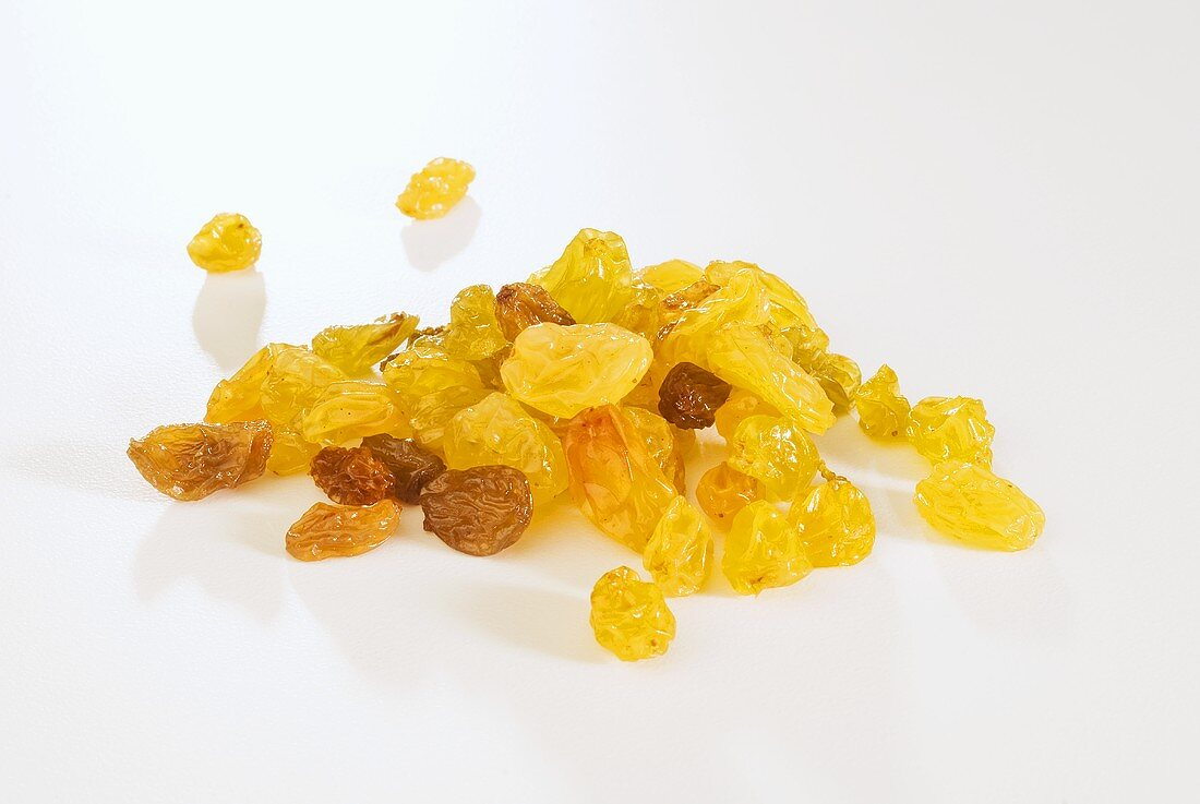 Small Pile of Golden Raisins on White