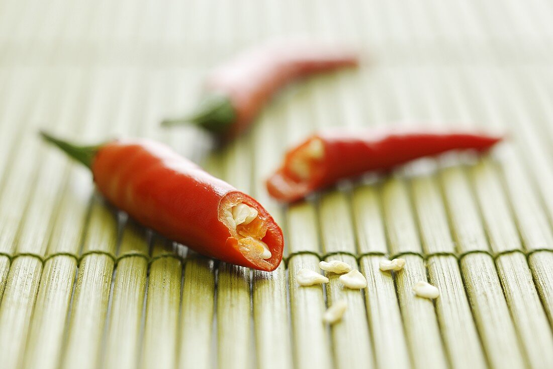 Chilli, cut in half, on bamboo mat