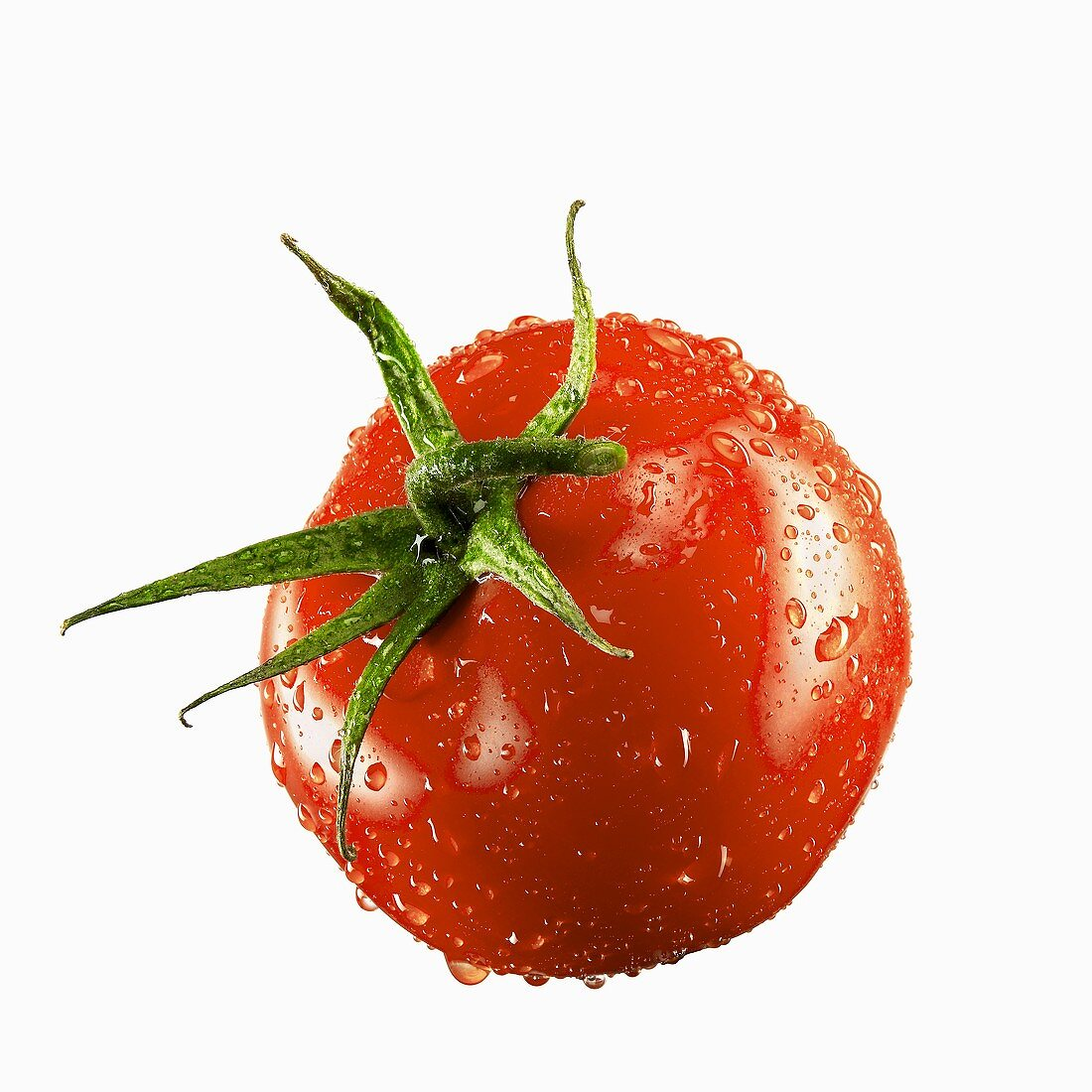 A tomato with drops of water