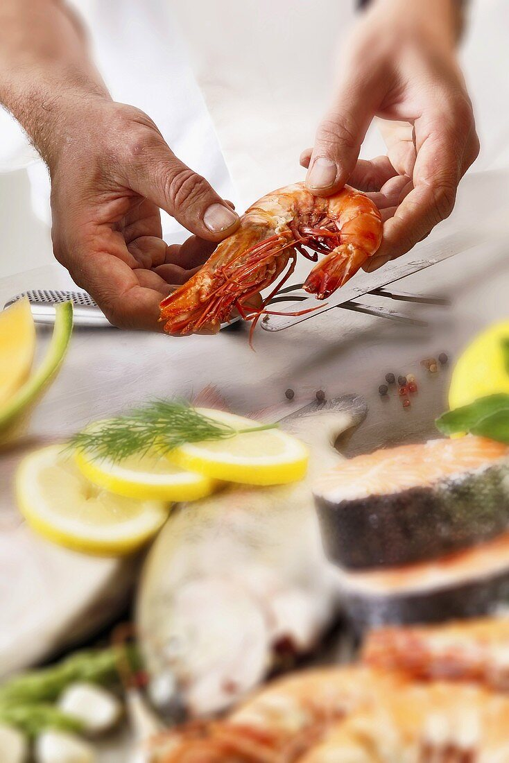 Chef holding king prawn