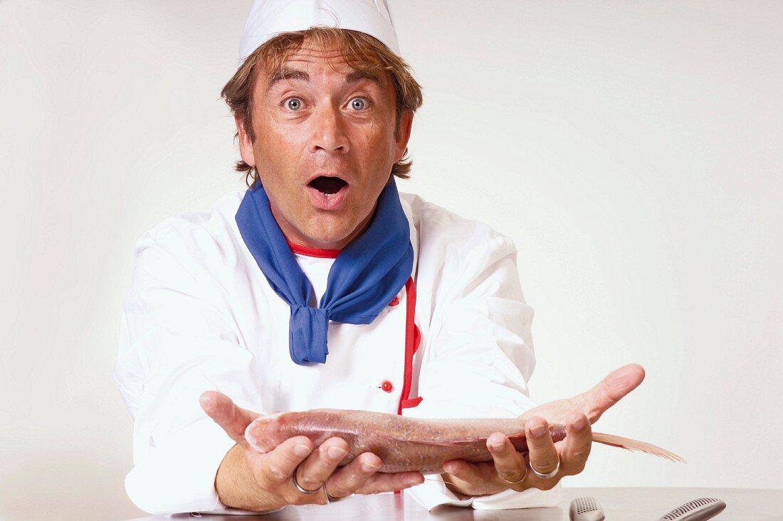Chef holding fresh gilthead bream