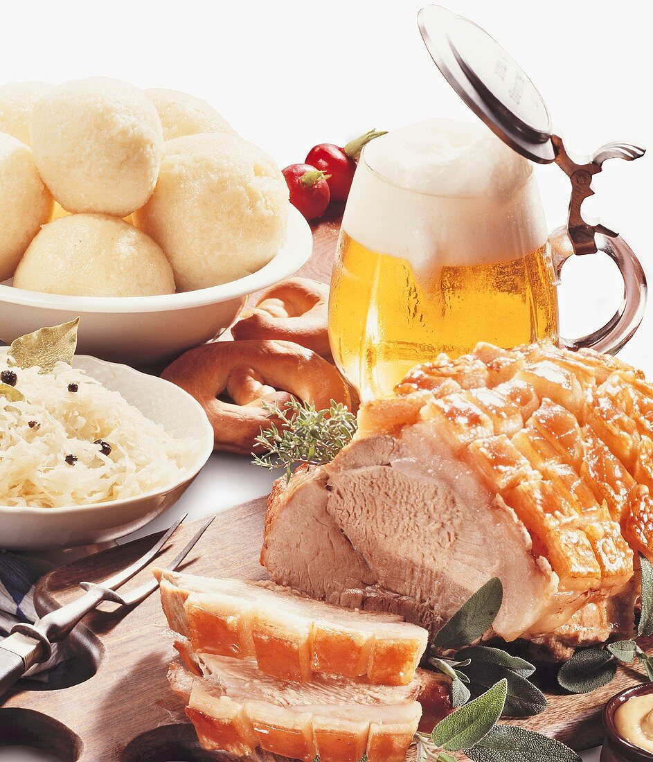Roast pork with sauerkraut, potato dumplings & beer (Bavaria)