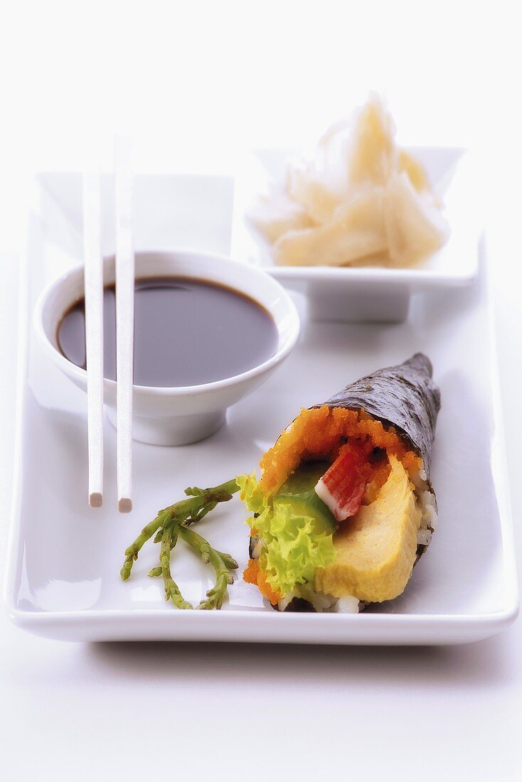 Temaki sushi with soy sauce and ginger