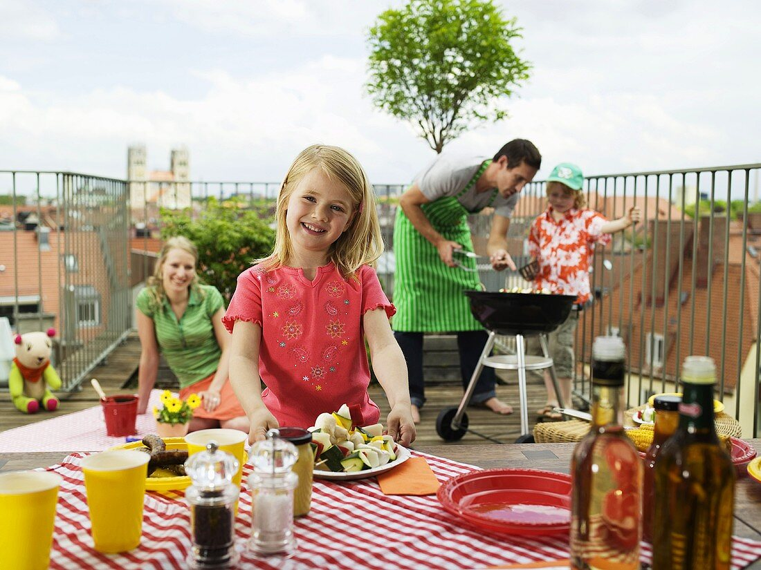 Family having barbecue on balcony