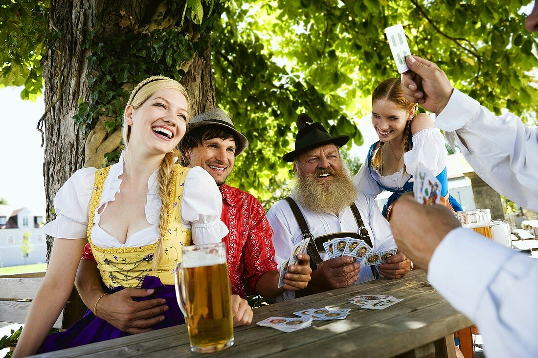 People playing cards in beer garden