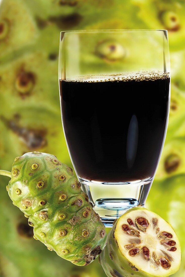 Noni juice, fresh fruits aside, close-up