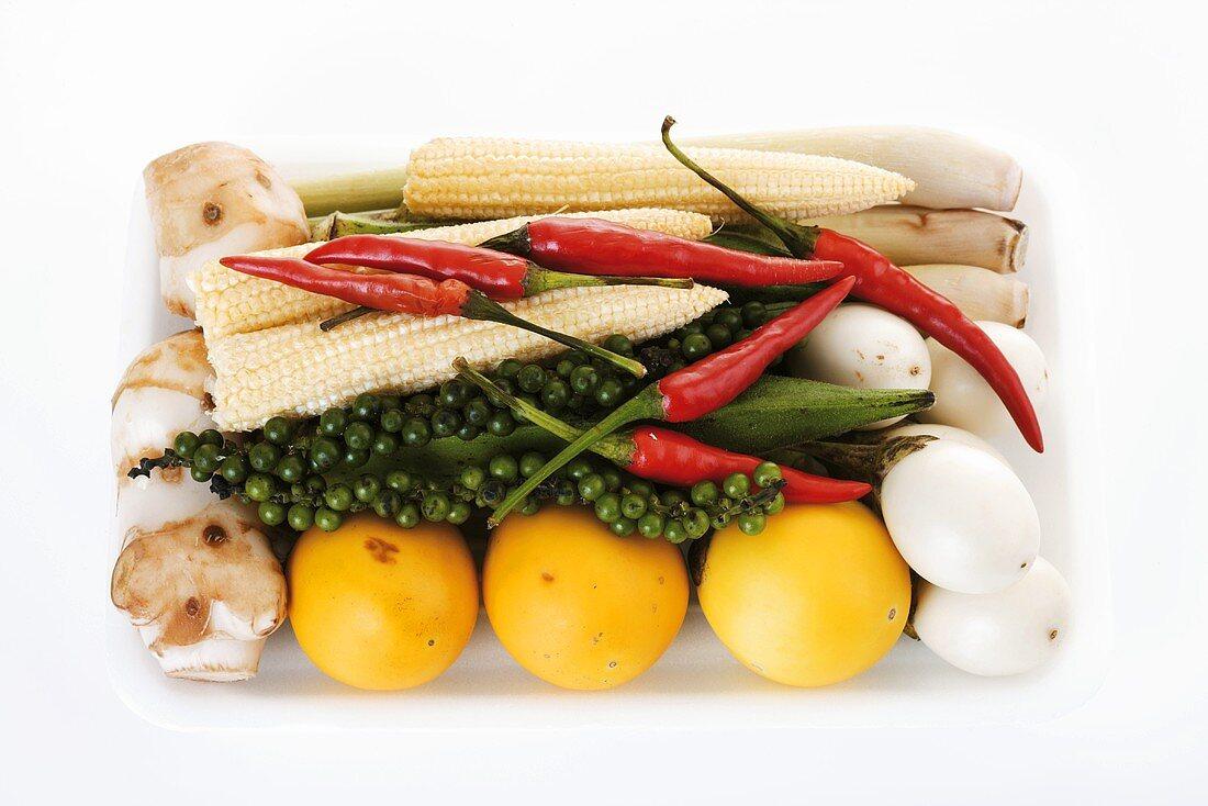Aubergines, baby corn, peppercorns, chillies, lemon grass & ginger