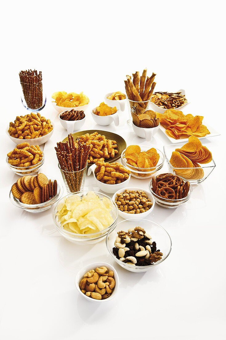 Assorted snacks (salted snacks, trail mix, crisps, crackers, nuts)