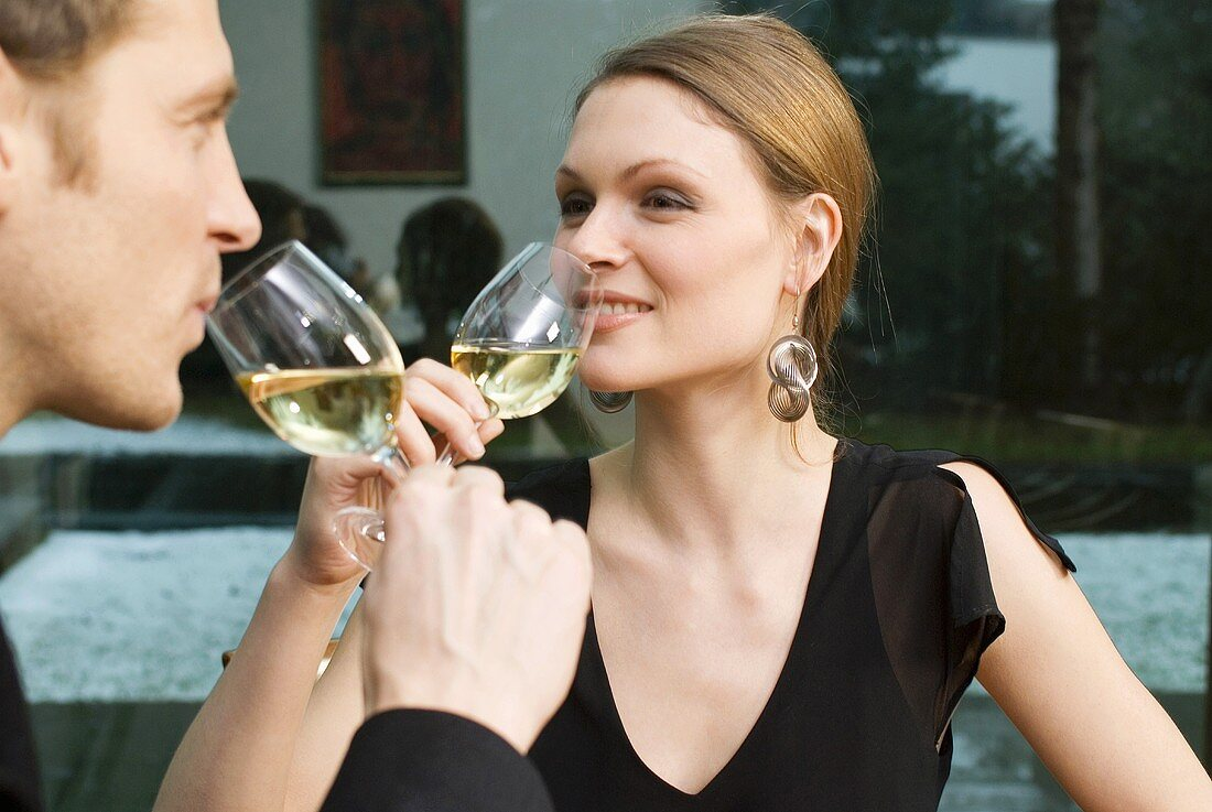 Young couple drinking white wine