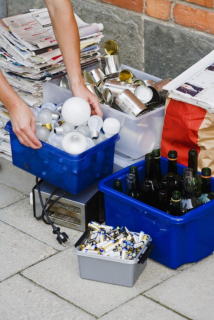 Waste for recycling (light bulbs, bottles, tins, paper, batteries)