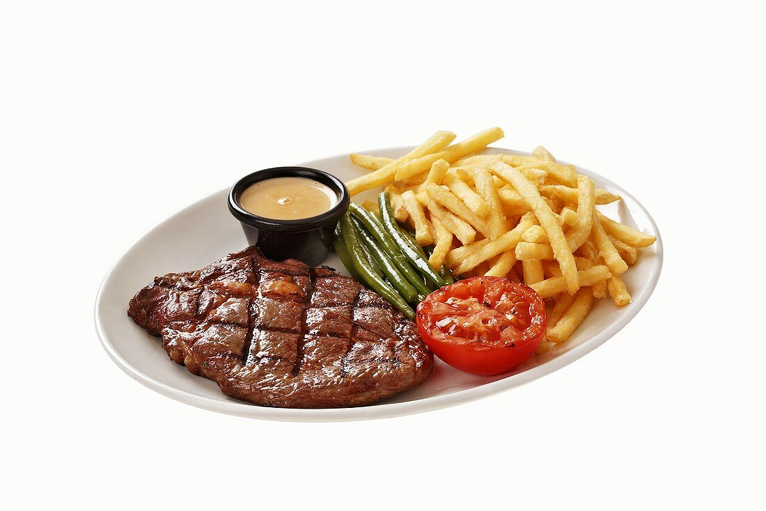 Beefsteak with chips and vegetables