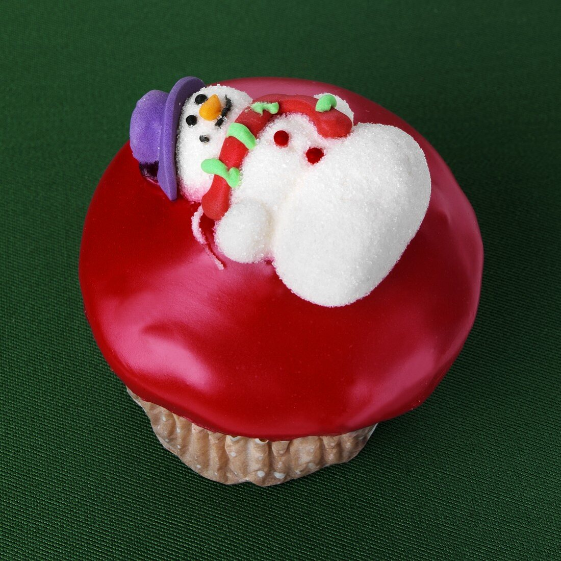 Cupcake with snowman decoration