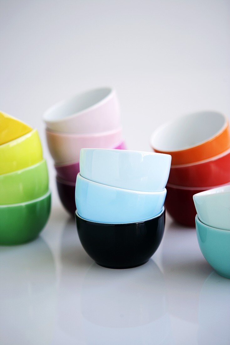 Many coloured bowls, stacked