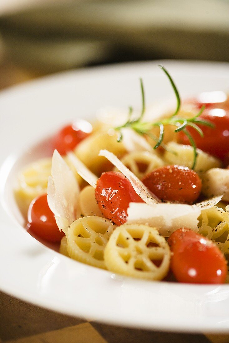 Wagon Wheel Pasta with Tomatoes and Parmesan Cheese