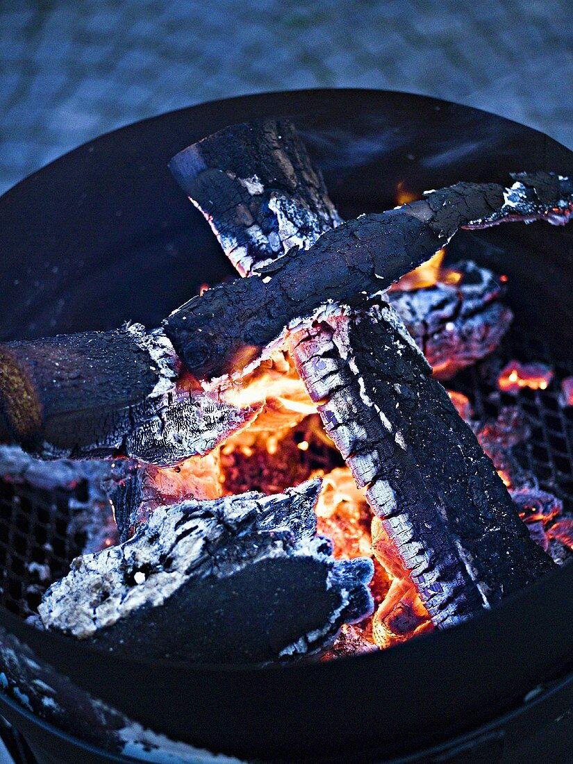Glowing charcoal in barbecue