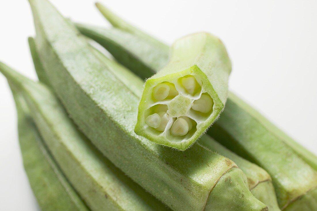 Several okra pods, one halved (close-up)