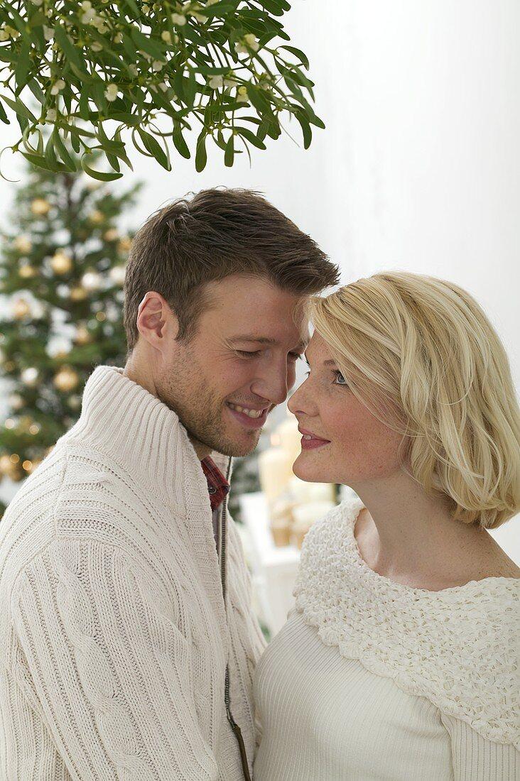 Man and woman under mistletoe