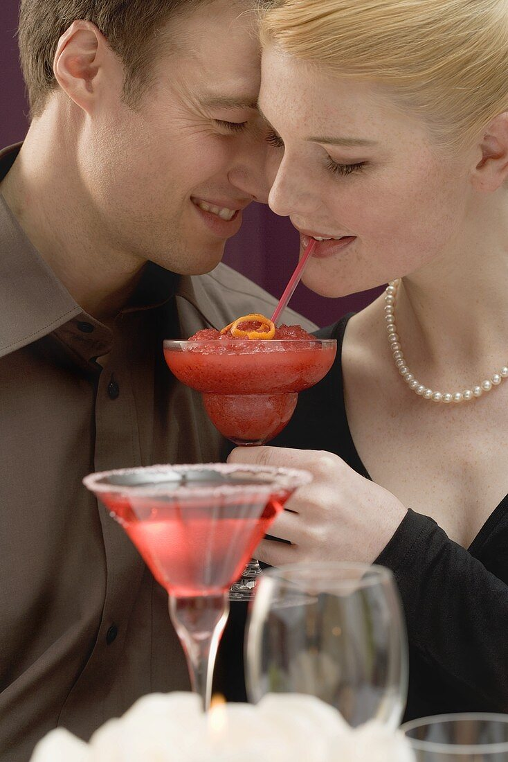 Romantic couple with drinks