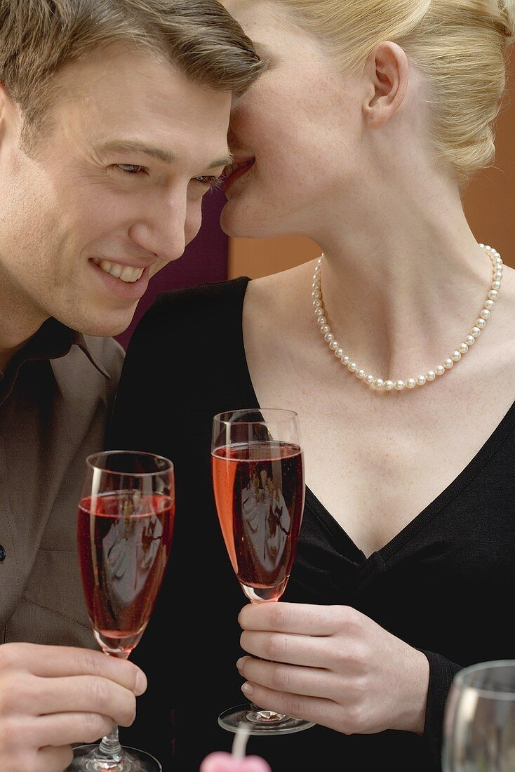 Romantic couple with glasses of sparkling wine