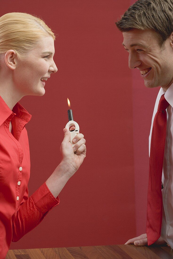 Laughing couple with gas lighter