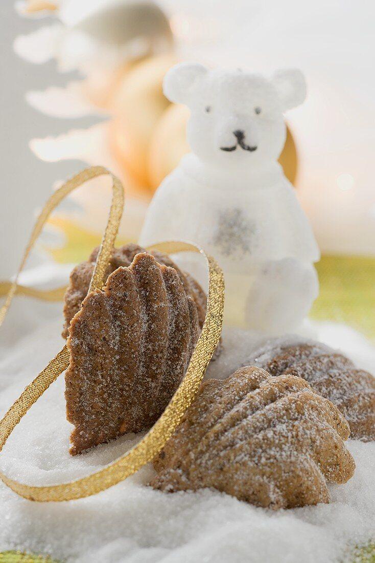 Bear's paw cookies on sugar, polar bear candle, Xmas decorations