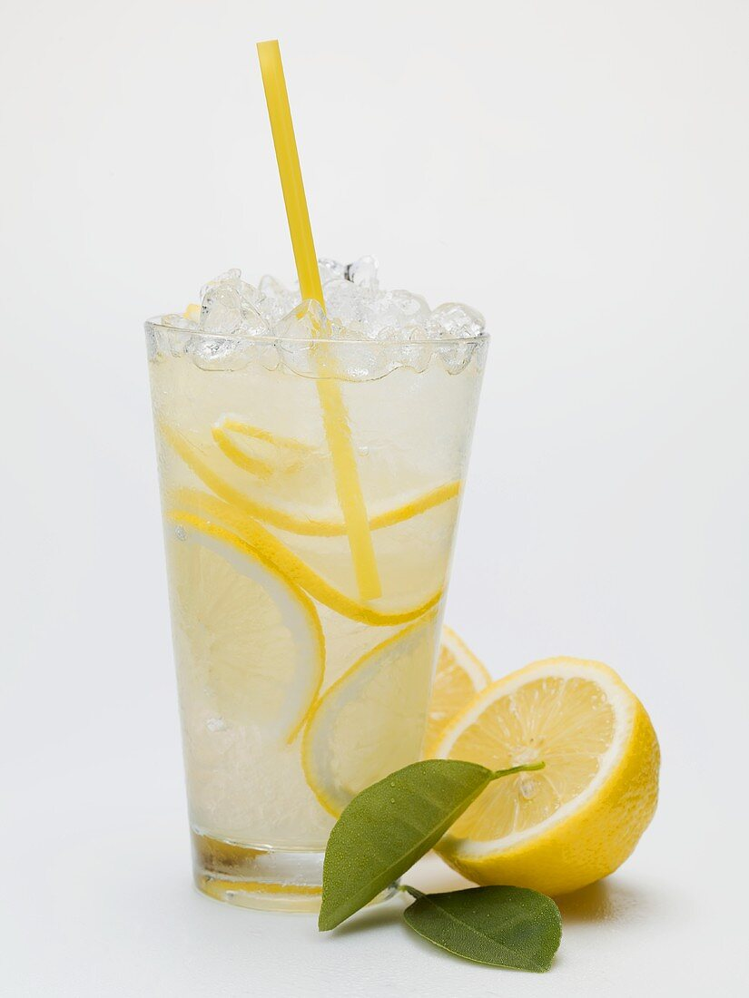 A glass of lemonade with crushed ice and straw