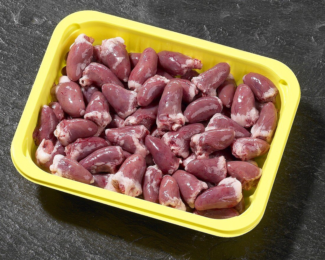 Chicken hearts in plastic container