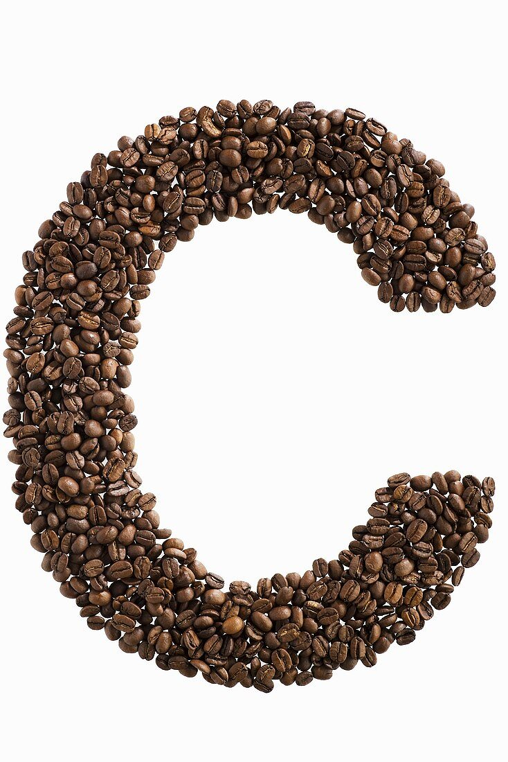 The letter C written in coffee beans
