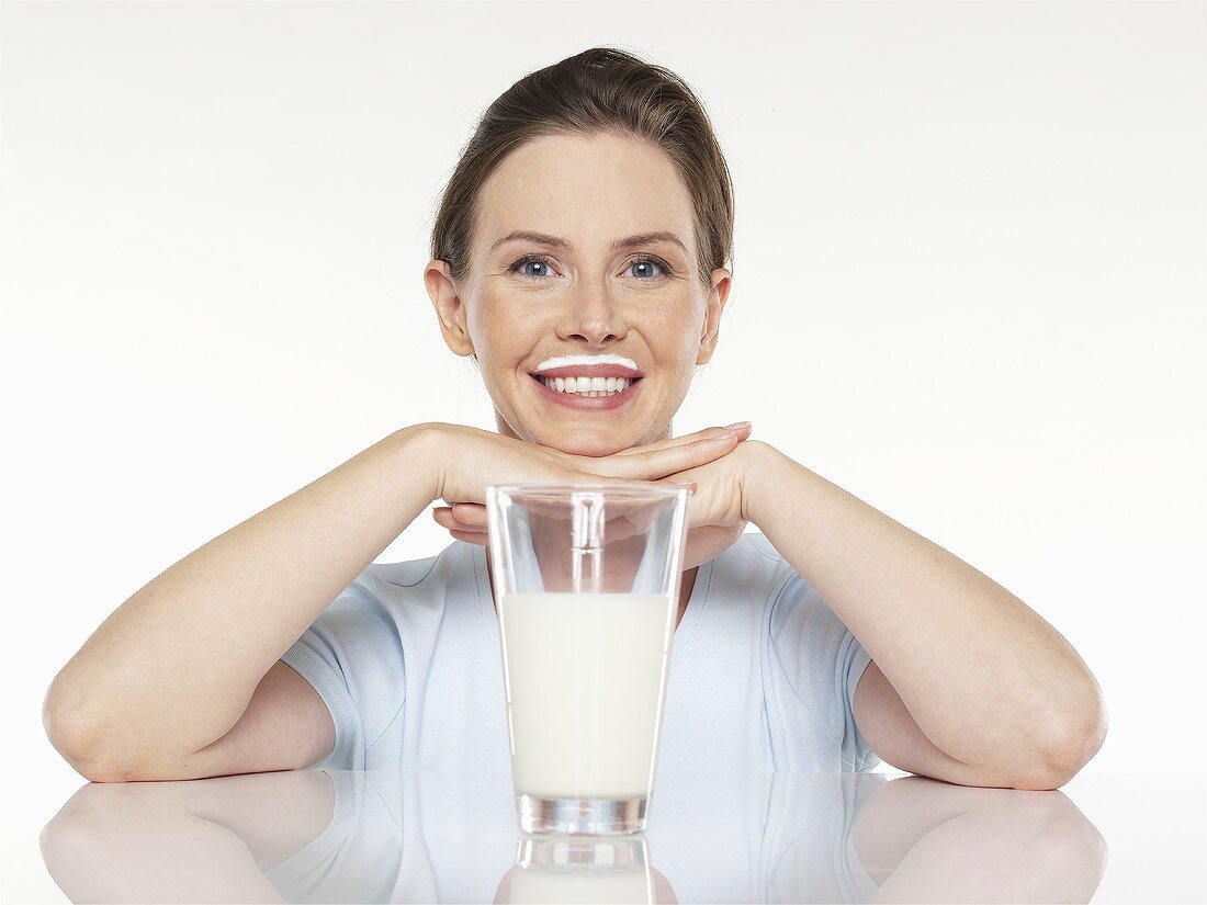Young woman with a glass of milk