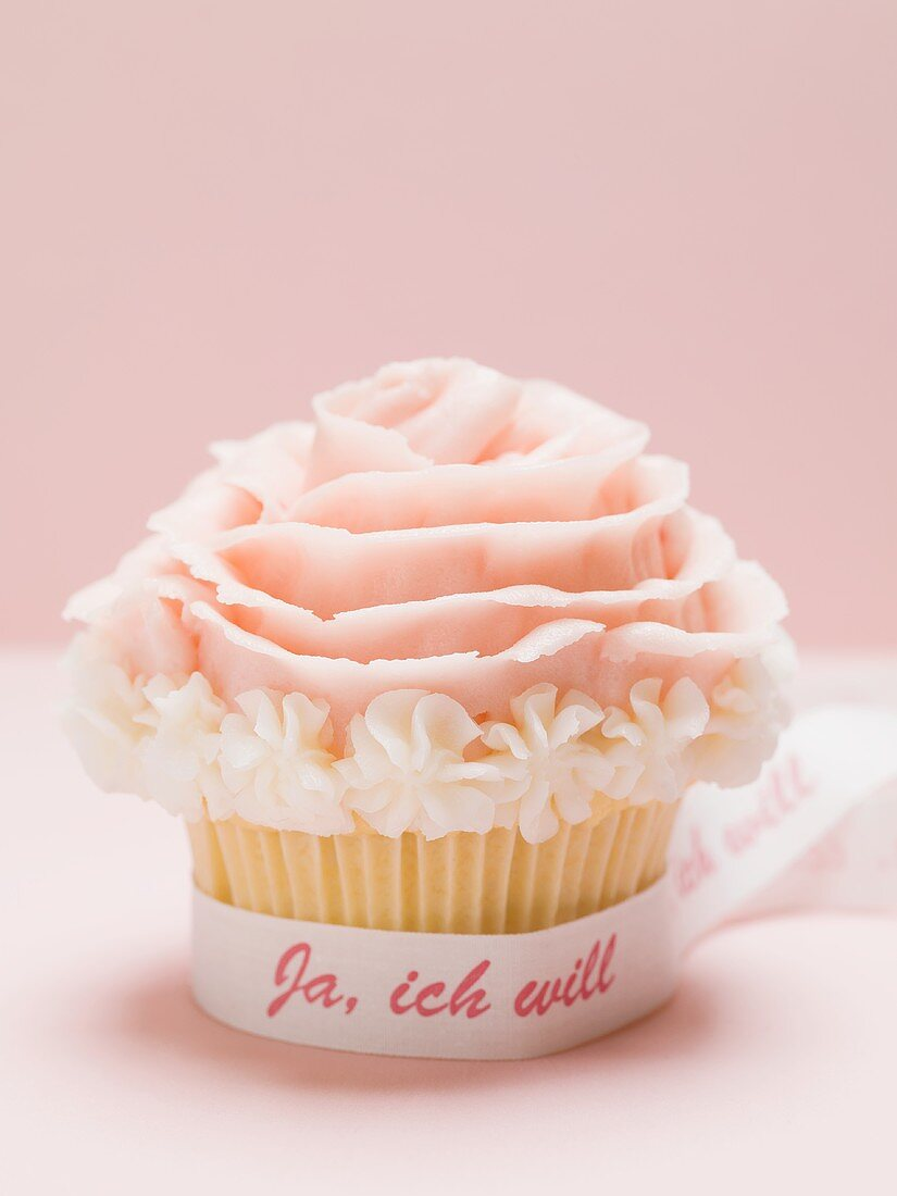 Cupcake with marzipan rose for wedding