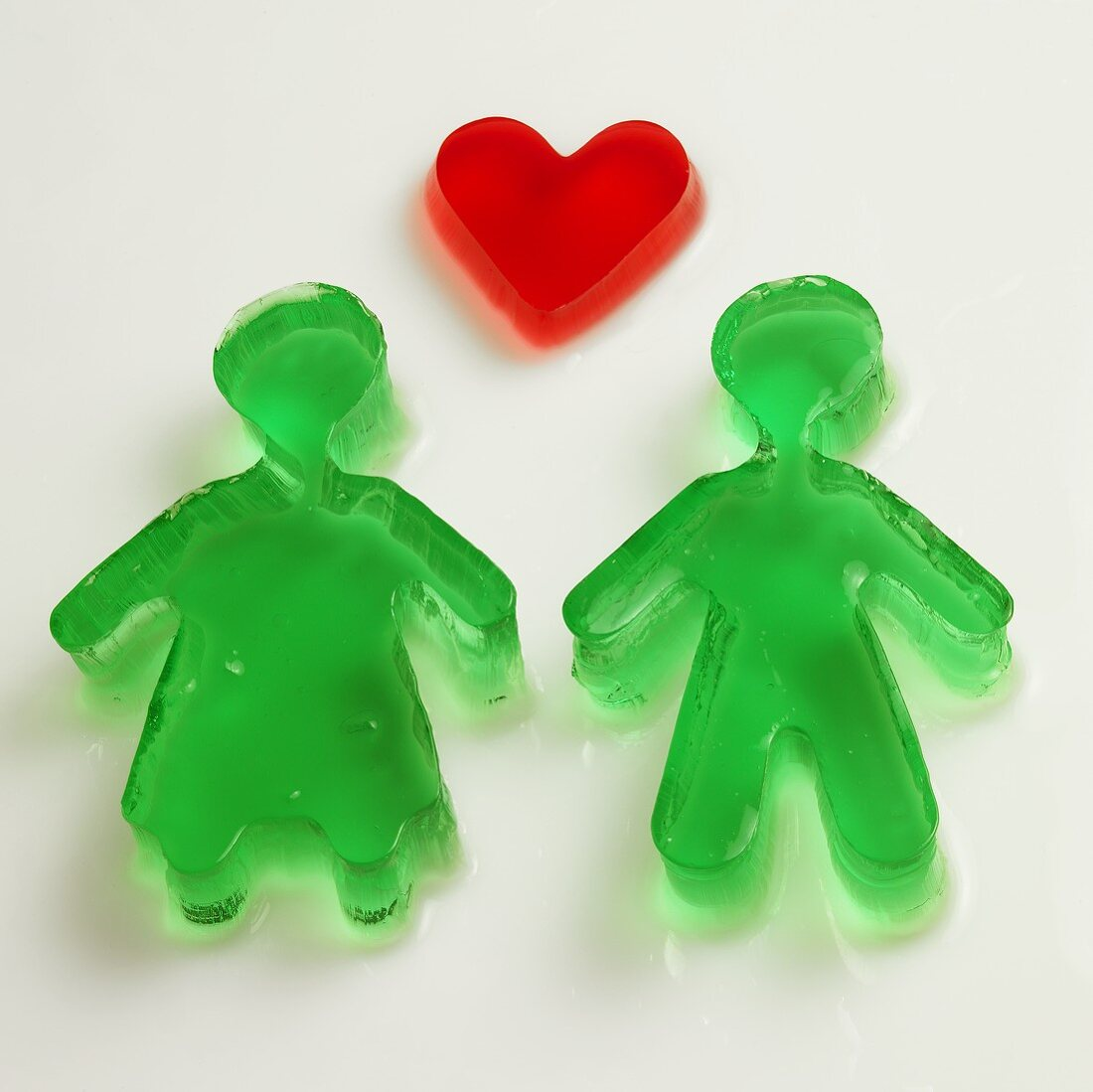 Red jelly heart and green figures in woodruff jelly
