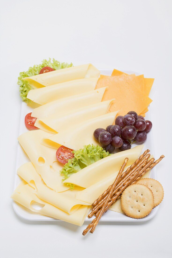 Cheese platter with grapes and nibbles
