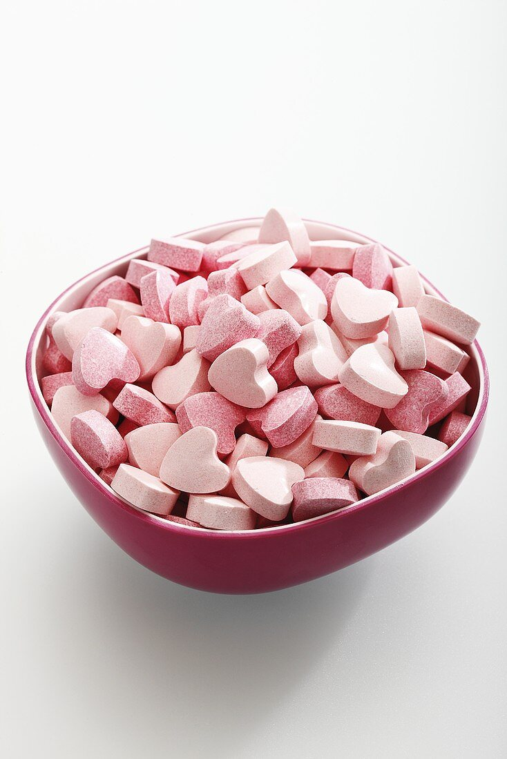 Pink glucose hearts in a bowl