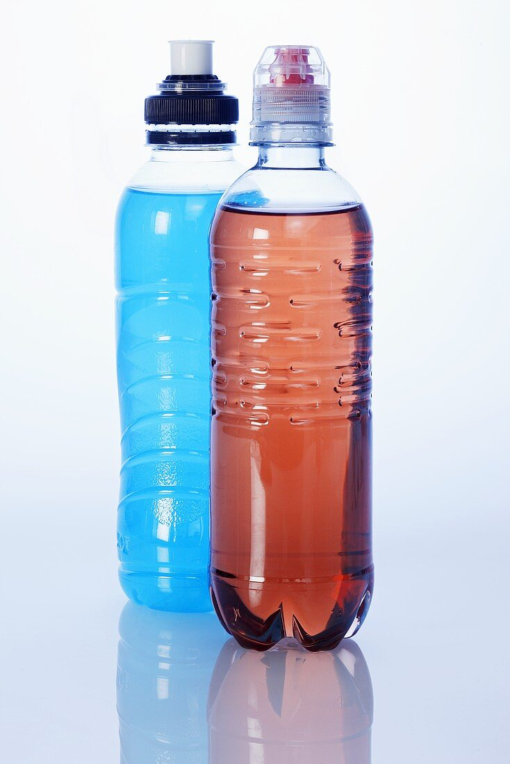 Two energy drinks (red and blue) in plastic bottles